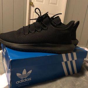 All black Adidas Tubulars